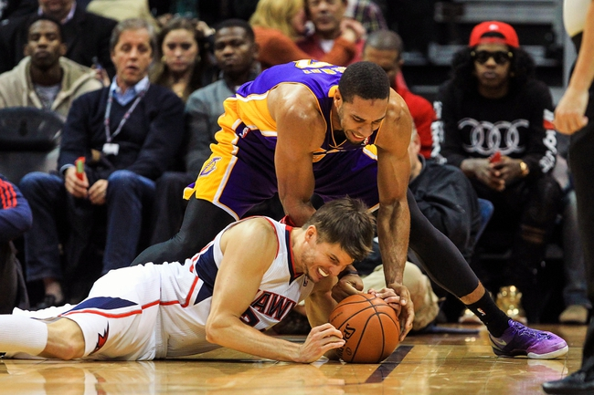 Dec 16, 2013; Atlanta, GA, USA; Atlanta Hawks shooting guard Kyle Korver (26) and Los Angeles Lakers small forward Xavier Henry (7) battle for a loose ball in the second half at Philips Arena. The Hawks won 114-100. Mandatory Credit: Daniel Shirey-USA TODAY Sports