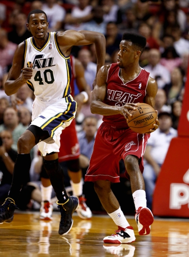 Dec 16, 2013; Miami, FL, USA;  Miami Heat point guard Norris Cole (30) dribbles the ball up court ahead of Utah Jazz small forward Jeremy Evans (40) in the first half at American Airlines Arena. Mandatory Credit: Robert Mayer-USA TODAY Sports