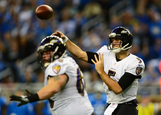 Dec 16, 2013; Detroit, MI, USA; Baltimore Ravens quarterback Joe Flacco (5) throws a pass during the third quarter against the Detroit Lions  at Ford Field. Mandatory Credit: Andrew Weber-USA TODAY Sports