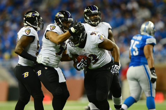Dec 16, 2013; Detroit, MI, USA; Baltimore Ravens defensive end DeAngelo Tyson (93) celebrates with teammates after intercepting a pass during the third quarter against the Detroit Lions at Ford Field. Mandatory Credit: Andrew Weber-USA TODAY Sports