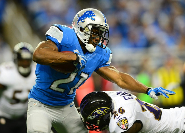 Dec 16, 2013; Detroit, MI, USA; Detroit Lions running back Reggie Bush (21) is tackled by Baltimore Ravens free safety Matt Elam (26) during the third quarter at Ford Field. Mandatory Credit: Andrew Weber-USA TODAY Sports