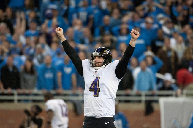 Dec 16, 2013; Detroit, MI, USA; Baltimore Ravens punter Sam Koch (4) celebrates kicker Justin Tucker (not pictured) game winning field goal during the fourth quarter against the Detroit Lions  at Ford Field. Ravens won 18-16. Mandatory Credit: Tim Fuller-USA TODAY Sports