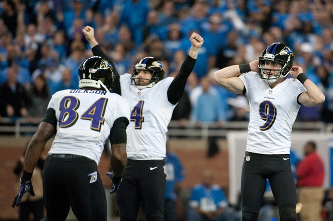 Dec 16, 2013; Detroit, MI, USA; Baltimore Ravens kicker Justin Tucker (9) celebrates his game winning field goal with punter Sam Koch (4) and tight end Ed Dickson (84) during the fourth quarter against the Detroit Lions at Ford Field. Ravens won 18-16. Mandatory Credit: Tim Fuller-USA TODAY Sports