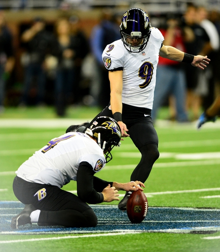 Dec 16, 2013; Detroit, MI, USA; Baltimore Ravens kicker Justin Tucker (9) kicks a 61 yard field goal during the fourth quarter against the Detroit Lions at Ford Field. Baltimore Ravens defeated the Detroit Lions 18-16. Mandatory Credit: Andrew Weber-USA TODAY Sports