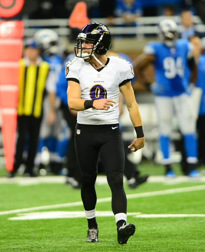 Dec 16, 2013; Detroit, MI, USA; Baltimore Ravens kicker Justin Tucker (9) celebrates after kicking a 61 yard field goal during the fourth quarter against the Detroit Lions at Ford Field. Baltimore Ravens defeated the Detroit Lions 18-16. Mandatory Credit: Andrew Weber-USA TODAY Sports