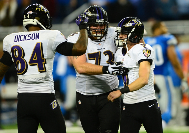 Dec 16, 2013; Detroit, MI, USA; Baltimore Ravens kicker Justin Tucker (9) celebrates with guard Marshal Yanda (73) and tight end Ed Dickson (84) after kicking a 61 yard field goal during the fourth quarter against the Detroit Lions at Ford Field. Baltimore Ravens defeated the Detroit Lions 18-16. Mandatory Credit: Andrew Weber-USA TODAY Sports