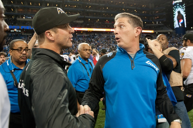 Dec 16, 2013; Detroit, MI, USA; Baltimore Ravens head coach John Harbaugh (left) and Detroit Lions head coach Jim Schwartz (right) shake hands after the game at Ford Field. Ravens won 18-16. Mandatory Credit: Tim Fuller-USA TODAY Sports