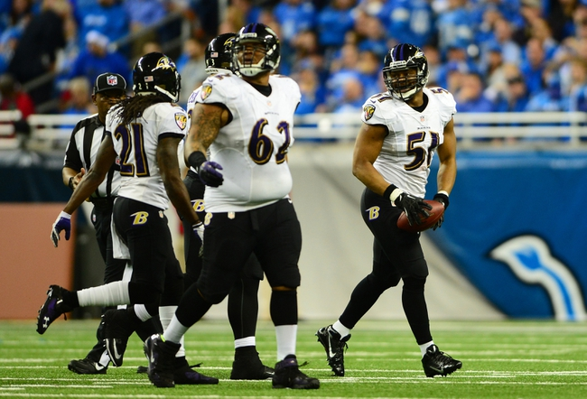 Dec 16, 2013; Detroit, MI, USA; Baltimore Ravens inside linebacker Daryl Smith (51) celebrates with teammates after intercepting a pass during the fourth quarter against the Detroit Lions at Ford Field. Baltimore Ravens defeated the Detroit Lions 18-16. Mandatory Credit: Andrew Weber-USA TODAY Sports