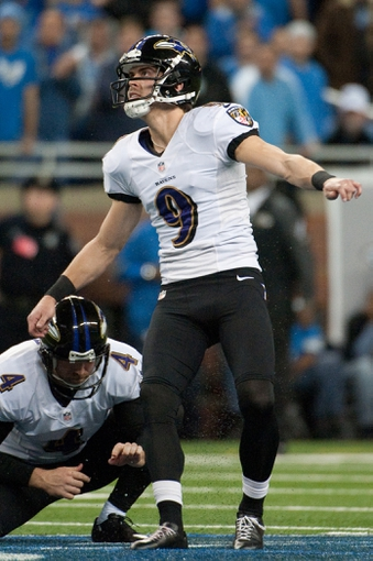 Dec 16, 2013; Detroit, MI, USA; Baltimore Ravens kicker Justin Tucker (9) watches on after kicking the game winning field goal during the fourth quarter against the Detroit Lions at Ford Field. Ravens won 18-16. Mandatory Credit: Tim Fuller-USA TODAY Sports