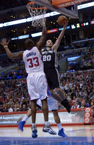 Dec 16, 2013; Los Angeles, CA, USA; San Antonio Spurs guard Manu Ginobili (20) is defended by Los Angeles Clippers forward Antawn Jamison (33) at Staples Center. The Clippers defeated the Spurs 115-92. Mandatory Credit: Kirby Lee-USA TODAY Sports