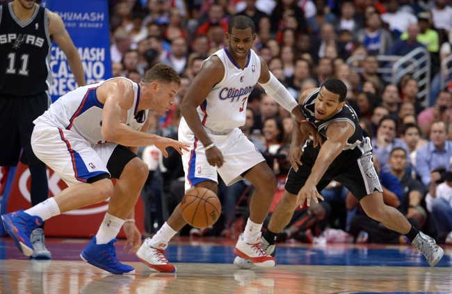 Dec 16, 2013; Los Angeles, CA, USA; Los Angeles Clippers forward Blake Griffin (32) and guard Chris Paul (3) battle for the ball with San Antonio Spurs guard Cory Joseph (5) at Staples Center. The Clippers defeated the Spurs 115-92. Mandatory Credit: Kirby Lee-USA TODAY Sports