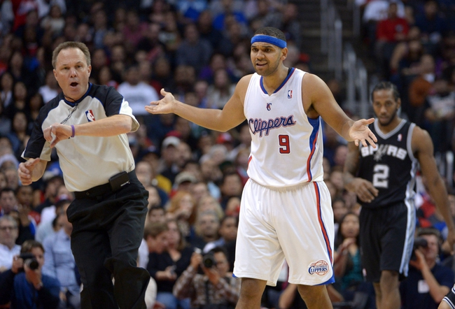 Dec 16, 2013; Los Angeles, CA, USA; Los Angeles Clippers forward Jared Dudley (9) reacts to a foul called by referee Bill Spooner during the game against the San Antonio Spurs at Staples Center. The Clippers defeated the Spurs 115-92. Mandatory Credit: Kirby Lee-USA TODAY Sports