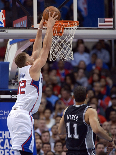 Dec 16, 2013; Los Angeles, CA, USA; Los Angeles Clippers forward Blake Griffin (32) dunks the ball as San Antonio Spurs forward Jeff Ayres (11) defends at Staples Center. The Clippers defeated the Spurs 115-92. Mandatory Credit: Kirby Lee-USA TODAY Sports