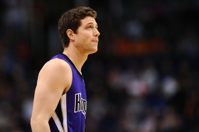 Nov 20, 2013; Phoenix, AZ, USA; Sacramento Kings guard Jimmer Fredette (7) in action in the second half of the game against the Phoenix Suns at US Airways Center. The Kings defeated the Suns 113-106. Mandatory Credit: Jennifer Stewart-USA TODAY Sports