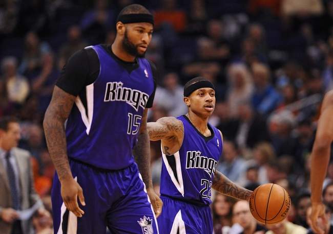 Nov 20, 2013; Phoenix, AZ, USA; Sacramento Kings guard Isaiah Thomas (22) dribbles the ball up the court along side center DeMarcus Cousins (15) against the Phoenix Suns in the first half at US Airways Center. The Kings defeated the Suns 113-106. Mandatory Credit: Jennifer Stewart-USA TODAY Sports