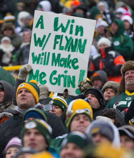 Dec 8, 2013; Green Bay, WI, USA; A Green Bay Packers fan holds up a sign supporting quarterback Matt Flynn (not pictured) during the game against the Atlanta Falcons at Lambeau Field.  Green Bay won 22-21.  Mandatory Credit: Jeff Hanisch-USA TODAY Sports