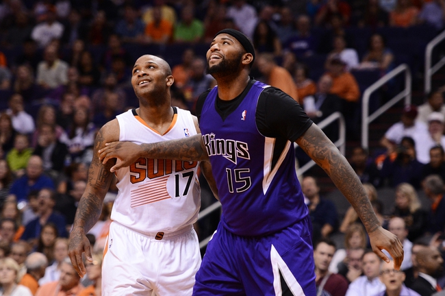 Nov 20, 2013; Phoenix, AZ, USA; Sacramento Kings center DeMarcus Cousins (15) boxes out Phoenix Suns forward P.J Tucker (17) at US Airways Center. The Kings defeated the Suns 113-106. Mandatory Credit: Jennifer Stewart-USA TODAY Sports