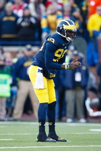 Nov 30, 2013; Ann Arbor, MI, USA; Michigan Wolverines quarterback Devin Gardner (98) gets set to run a play against the Ohio State Buckeyes at Michigan Stadium. Mandatory Credit: Rick Osentoski-USA TODAY Sports