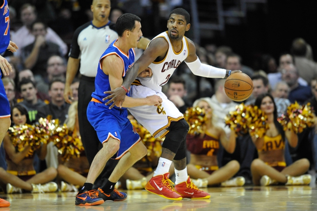 Dec 10, 2013; Cleveland, OH, USA; Cleveland Cavaliers point guard Kyrie Irving (right) dribbles against New York Knicks point guard Pablo Prigioni at Quicken Loans Arena. Cleveland won 109-94. Mandatory Credit: David Richard-USA TODAY Sports