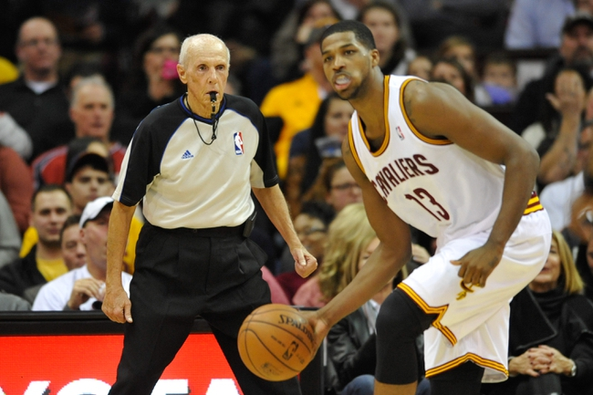 Dec 10, 2013; Cleveland, OH, USA; NBA referee Dick Bavetta watches Cleveland Cavaliers power forward Tristan Thompson (13) during a game with New York Knicks at Quicken Loans Arena. Cleveland won 109-94. Mandatory Credit: David Richard-USA TODAY Sports