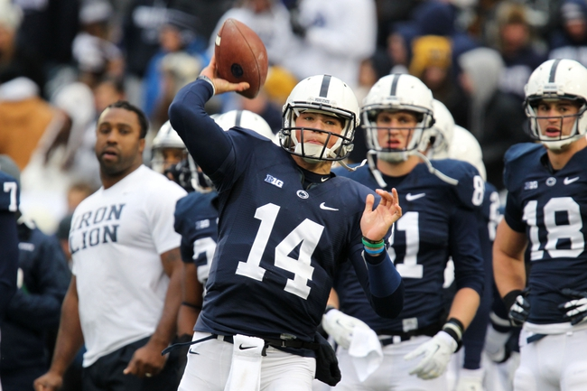 Nov 23, 2013; University Park, PA, USA; Penn State Nittany Lions quarterback Christian Hackenberg (14) throws a pass prior to the game against the Nebraska Cornhuskers at Beaver Stadium. Nebraska defeated Penn State 23-20 in overtime. Mandatory Credit: Matthew O'Haren-USA TODAY Sports