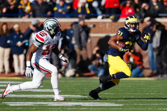 Nov 30, 2013; Ann Arbor, MI, USA; Michigan Wolverines wide receiver Jeremy Gallon (21) runs the ball defended by Ohio State Buckeyes cornerback Doran Grant (12) at Michigan Stadium. Mandatory Credit: Rick Osentoski-USA TODAY Sports