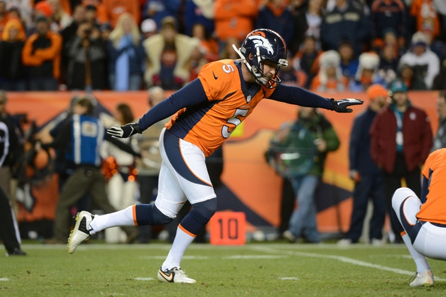 November 17, 2013; Denver, CO, USA; Denver Broncos kicker Matt Prater (5) kicks a point-after-touchdown during the first quarter against the Kansas City Chiefs at Sports Authority Field at Mile High. The Broncos defeated the Chiefs 27-17. Mandatory Credit: Kyle Terada-USA TODAY Sports