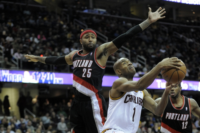 Dec 17, 2013; Cleveland, OH, USA; Cleveland Cavaliers point guard Jarrett Jack (1) drives between Portland Trail Blazers point guard Mo Williams (25) and power forward LaMarcus Aldridge (12) in the third quarter at Quicken Loans Arena. Mandatory Credit: David Richard-USA TODAY Sports