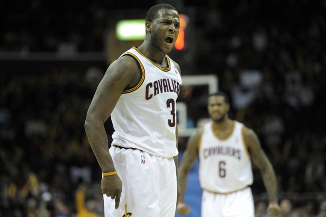 Dec 17, 2013; Cleveland, OH, USA; Cleveland Cavaliers shooting guard Dion Waiters (3) reacts after scoring a basket in the fourth quarter against the Portland Trail Blazers at Quicken Loans Arena. Mandatory Credit: David Richard-USA TODAY Sports