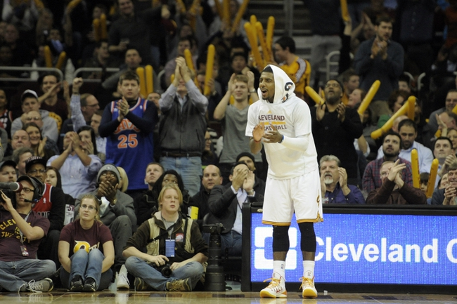 Dec 17, 2013; Cleveland, OH, USA; Cleveland Cavaliers point guard Kyrie Irving cheers near the bench in the fourth quarter against the Portland Trail Blazers at Quicken Loans Arena. Mandatory Credit: David Richard-USA TODAY Sports