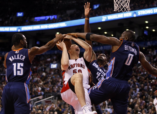 Dec 18, 2013; Toronto, Ontario, CAN; Charlotte Bobcats guard Kemba Walker (15) and forward Anthony Tolliver (43) and center-forward Bismack Biyombo (0) defend against Toronto Raptors forward Tyler Hansbrough (50) at the Air Canada Centre. Charlotte defeated Toronto 104-102 in overtime. Mandatory Credit: John E. Sokolowski-USA TODAY Sports