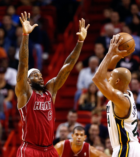 Dec 16, 2013; Miami, FL, USA;  Miami Heat small forward LeBron James (6) defends Utah Jazz small forward Richard Jefferson (24) in the first half at American Airlines Arena. Mandatory Credit: Robert Mayer-USA TODAY Sports