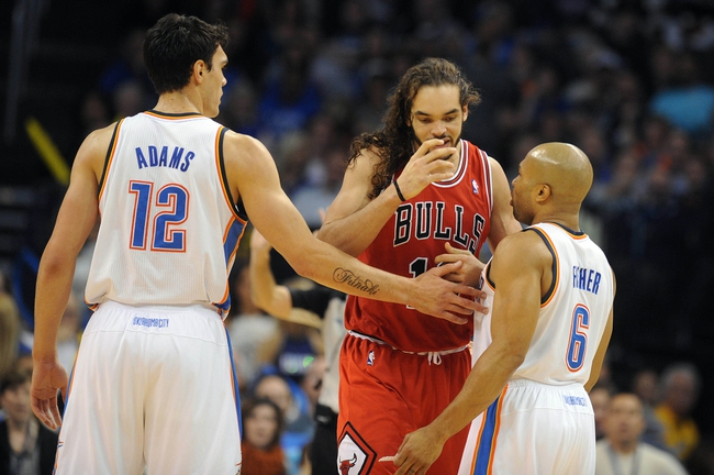 Dec 19, 2013; Oklahoma City, OK, USA; Oklahoma City Thunder point guard Derek Fisher (6) and Oklahoma City Thunder center Steven Adams (12) talk to Chicago Bulls center Joakim Noah (13) after a play during the third quarter at Chesapeake Energy Arena. Mandatory Credit: Mark D. Smith-USA TODAY Sports
