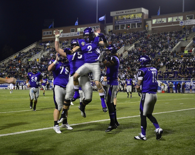 Dec 20, 2013; Salem, VA, USA; UW-Whitewater wide receiver Tyler Huber (2) celebrates with offensive linesmen Nick Ryczek (78) and Lucas Skibba (75) and wide receivers Jake Kumerow (1) and Justin Howard (11) after scoring a touchdown in the first quarter at Salem Stadium. Mandatory Credit: Bob Donnan-USA TODAY Sports