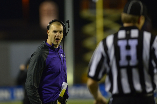 Dec 20, 2013; Salem, VA, USA; Mount Union Purple Raiders head coach Vince Kehres reacts with the official in the first quarter at Salem Stadium. Mandatory Credit: Bob Donnan-USA TODAY Sports