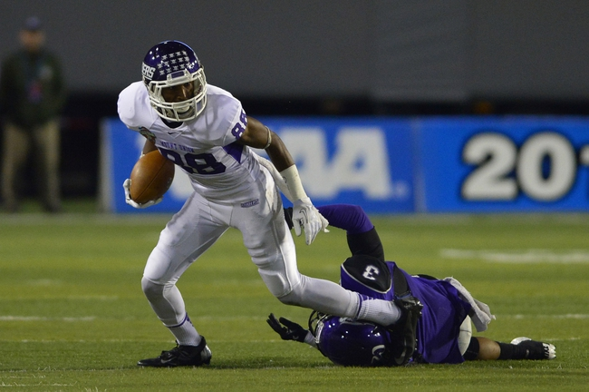 Dec 20, 2013; Salem, VA, USA; Mount Union Purple Raiders wide receiver Sherman Wilkinson (88) with the ball as UW-Whitewater defensive back Marcus McLin (3) defends in the second quarter at Salem Stadium. Mandatory Credit: Bob Donnan-USA TODAY Sports