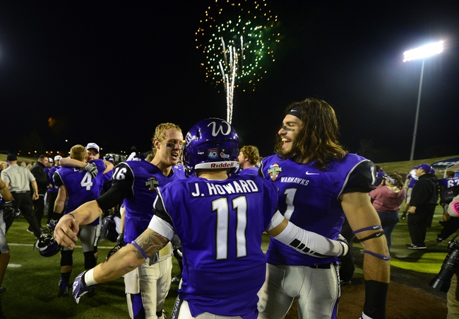 Dec 20, 2013; Salem, VA, USA; UW-Whitewater quarterback Matt Behrendt (16) and UW-Whitewater wide receivers Justin Howard (11) and Jake Kumerow (1) react after the game. UW-Whitewater defeated Mount Union Purple Raiders 52-14 at Salem Stadium. Mandatory Credit: Bob Donnan-USA TODAY Sports