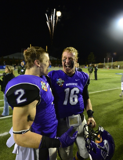 Dec 20, 2013; Salem, VA, USA; UW-Whitewater wide receiver Tyler Huber (2) and quarterback Matt Behrendt (16) react after the game. UW-Whitewater defeated Mount Union Purple Raiders 52-14 at Salem Stadium. Mandatory Credit: Bob Donnan-USA TODAY Sports