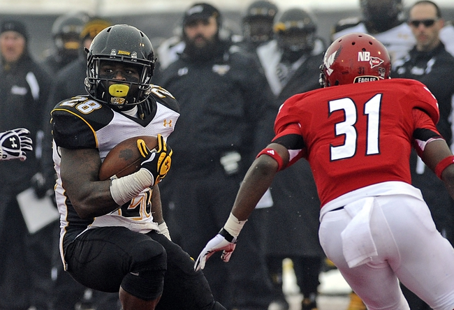Dec 21, 2013; Cheney, WA, USA; Towson Tigers running back Terrance West (28) cut back against Eastern Washington Eagles defensive back T.J. Lee III (31) during the second half at Roos Field. The Tiger beat Eagles 35-31. Mandatory Credit: James Snook-USA TODAY Sports
