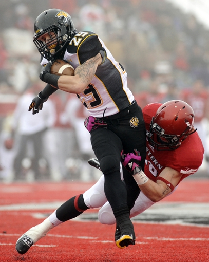 Dec 21, 2013; Cheney, WA, USA; Towson Tigers wide receiver Brian Dowling (29) is brought down by Eastern Washington Eagles defensive back Todd Raynes (38) during the second half at Roos Field. The Tiger beat Eagles 35-31. Mandatory Credit: James Snook-USA TODAY Sports