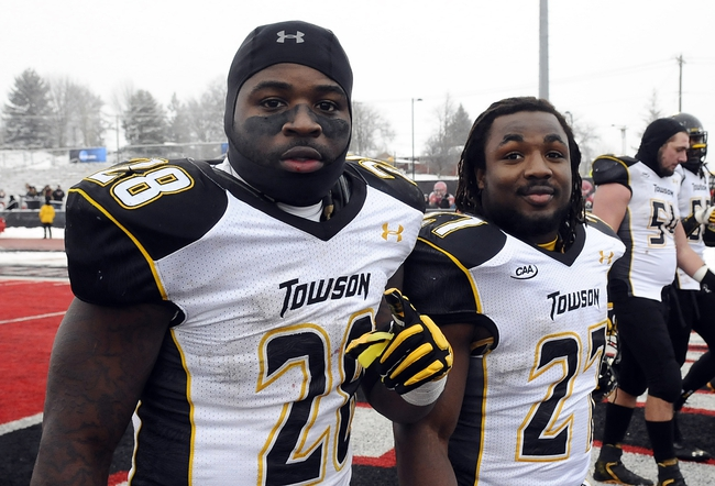 Dec 21, 2013; Cheney, WA, USA; Towson Tigers running back Terrance West (28) and Towson Tigers running back Darius Victor (27) celebrate after a game against the Eastern Washington Eagles at Roos Field. The Tiger beat Eagles 35-31. Mandatory Credit: James Snook-USA TODAY Sports