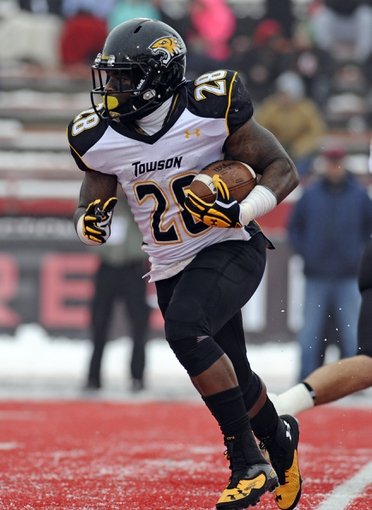 Dec 21, 2013; Cheney, WA, USA; Towson Tigers running back Terrance West (28) runs the ball against the Eastern Washington Eagles during the first  half at Roos Field. Mandatory Credit: James Snook-USA TODAY Sports