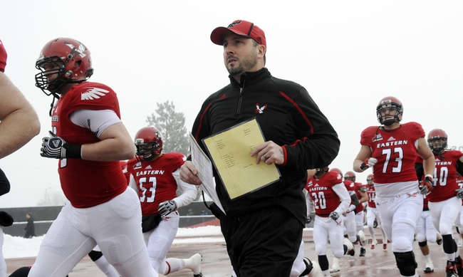 Dec 21, 2013; Cheney, WA, USA; Eastern Washington Eagles head coach Beau Baldwin runs out with his team before a game against the Towson Tigers at Roos Field. Mandatory Credit: James Snook-USA TODAY Sports