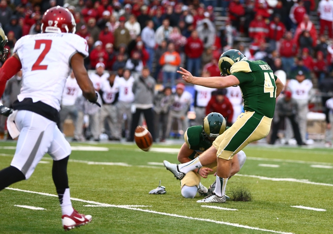 Dec 21, 2013; Albuquerque, NM, USA; Colorado State Rams kicker Jared Roberts kicks the game winning field goal in the fourth quarter against the Washington State Cougars during the Gildan New Mexico Bowl at University Stadium. The Rams defeated the Cougars 48-45. Mandatory Credit: Mark J. Rebilas-USA TODAY Sports