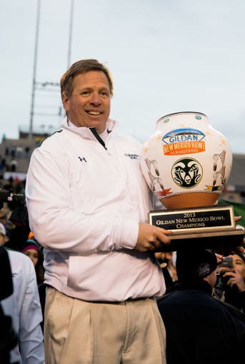 Dec 21, 2013; Albuquerque, NM, USA; Colorado State Rams head coach Jim McElwain celebrates with the trophy following the game against the Washington State Cougars during the Gildan New Mexico Bowl at University Stadium. The Rams defeated the Cougars 48-45. Mandatory Credit: Mark J. Rebilas-USA TODAY Sports