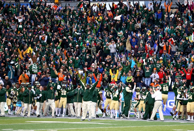 Dec 21, 2013; Albuquerque, NM, USA; Colorado State Rams players and fans celebrate after tying the score with a two point conversion in the fourth quarter against the Washington State Cougars during the Gildan New Mexico Bowl at University Stadium. The Rams defeated the Cougars 48-45. Mandatory Credit: Mark J. Rebilas-USA TODAY Sports