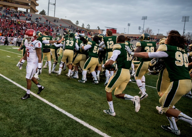 Dec 21, 2013; Albuquerque, NM, USA; Washington State Cougars wide receiver Rickey Galvin (5) leaves the field as Colorado State Rams celebrate their victory in the Gildan New Mexico Bowl at University Stadium. The Rams defeated the Cougars 48-45. Mandatory Credit: Mark J. Rebilas-USA TODAY Sports