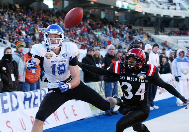 Dec 21, 2013; Boise, ID, USA; Buffalo Bulls wide receiver Alex Neutz (19) attempts to catch a pass in the end zone as San Diego State Aztecs defensive back J.J. Whittaker (34) defends during the first half of the Idaho Potato Bowl at Bronco Stadium. Mandatory Credit: Brian Losness-USA TODAY Sports