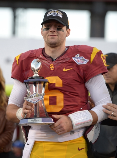 Dec 21, 2013; Las Vegas, NV, USA; Southern California Trojans quarterback Cody Kessler (6) holds the Las Vegas Bowl most valuable trophy after the game against the Fresno State Bulldogs at Sam Boyd Stadium. USC defeated Fresno State 45-20. Mandatory Credit: Kirby Lee-USA TODAY Sports