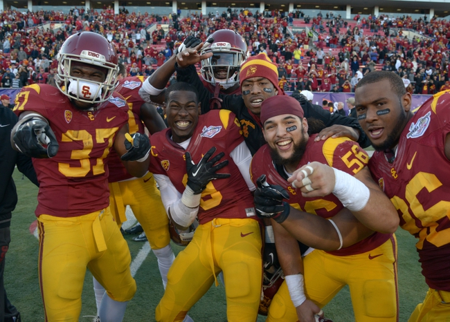 Dec 21, 2013; Las Vegas, NV, USA; Southern California Trojans players Javorious Allen (37), Marqise Lee (9), Anthony Sarao (56) and Xavier Grimble (86) celebrate after the Las Vegas Bowl against the Fresno State Bulldogs at Sam Boyd Stadium. USC defeated Fresno State 45-20. Mandatory Credit: Kirby Lee-USA TODAY Sports